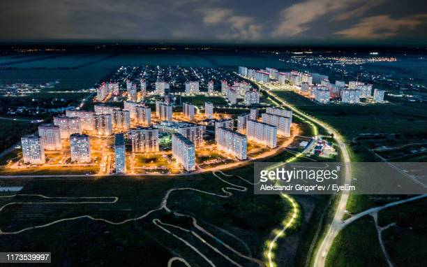 high angle view of city buildings against cloudy sky - rostov on don stock pictures, royalty-free photos & images