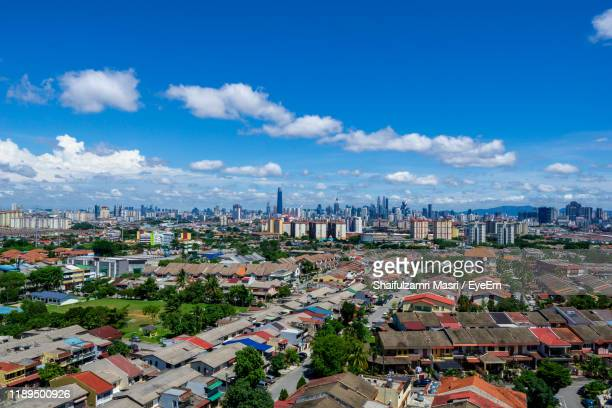 high angle view of city buildings against cloudy sky - shaifulzamri fotografías e imágenes de stock