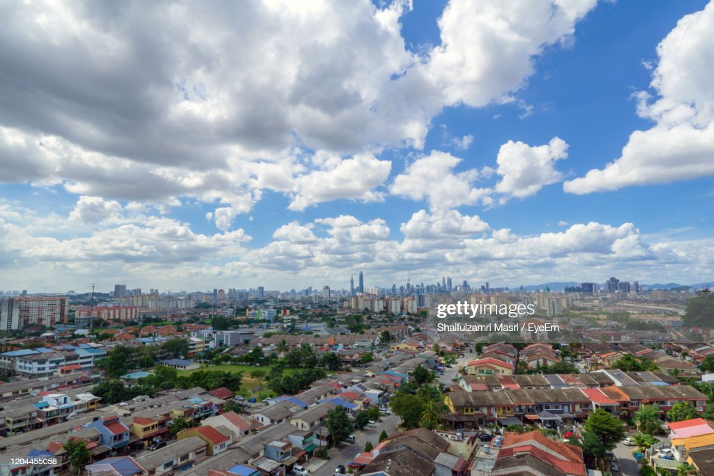 High Angle View Of City Buildings Against Cloudy Sky : Stock Photo