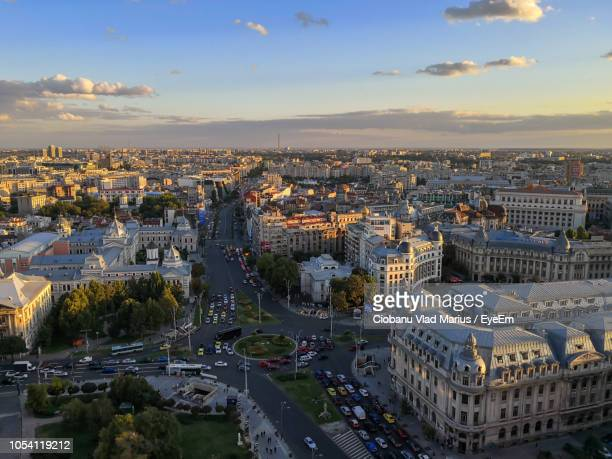high angle view of city buildings against sky during sunset - bucharest stock pictures, royalty-free photos & images