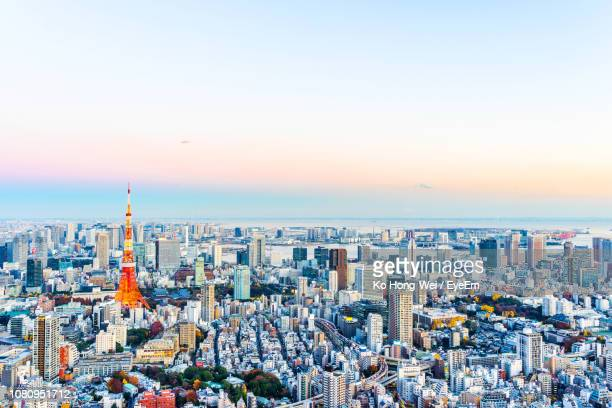 high angle view of city buildings against sky during sunset - 全景 ストックフォトと画像