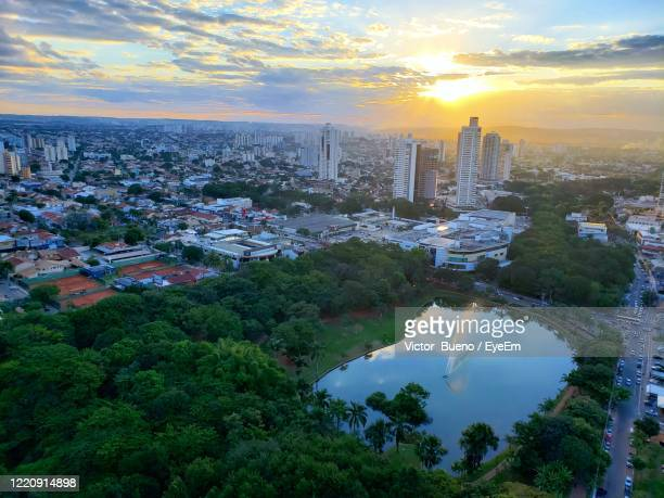 high angle view of city buildings against sky during sunset - goiania imagens e fotografias de stock