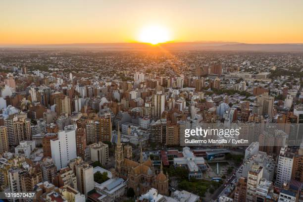 high angle view of city buildings against sky during sunset - cordoba argentina stock pictures, royalty-free photos & images