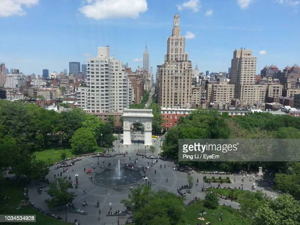 high angle view of city buildings against sky - washington square park stock pictures, royalty-free photos & images