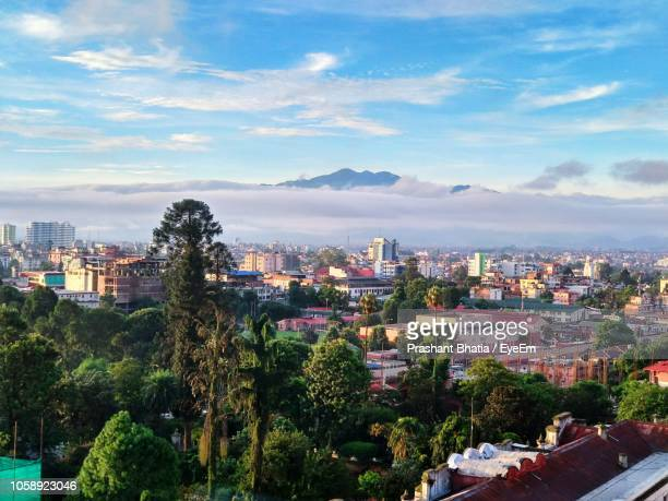 high angle view of city buildings against sky - nepal stock pictures, royalty-free photos & images