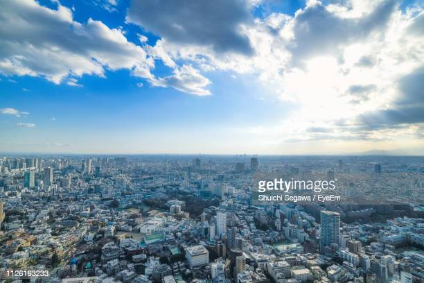 high angle view of city buildings against sky - 社会問題 ストックフォトと画像