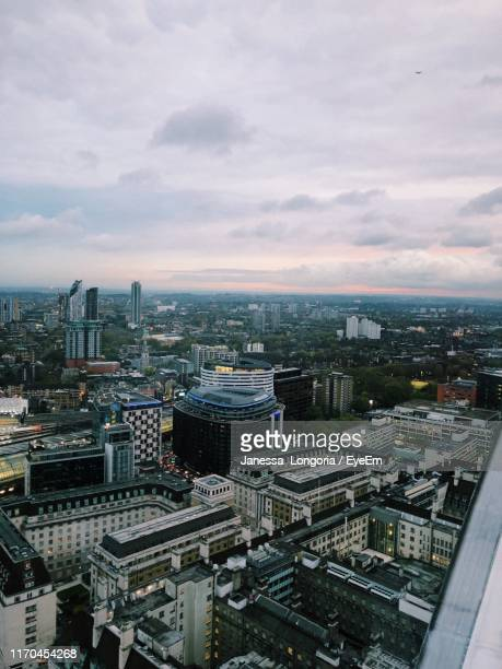 high angle view of city buildings against sky - janessa stock pictures, royalty-free photos & images