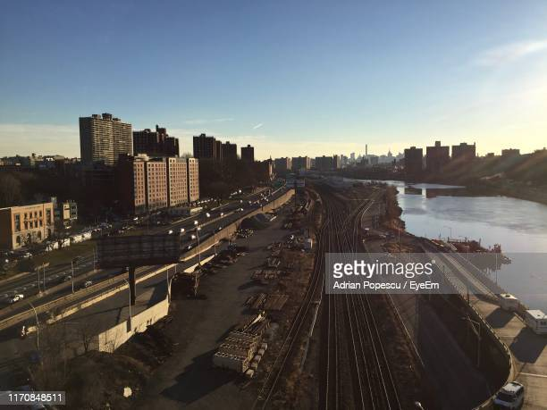 high angle view of city buildings against sky - the bronx stock pictures, royalty-free photos & images