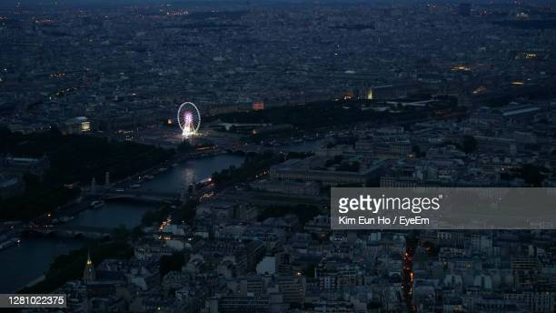 high angle view of city buildings at night - paris france stock pictures, royalty-free photos & images