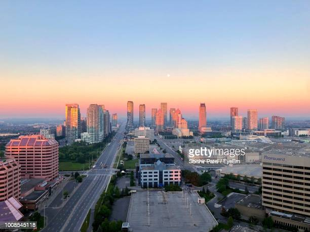 high angle view of city buildings during sunset - mississauga stock pictures, royalty-free photos & images