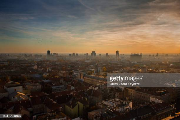 high angle view of city buildings during sunset - zagreb stock-fotos und bilder