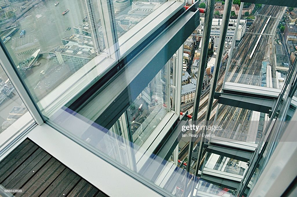 High Angle View Of City Buildings Seen Through Glass Structure : Stock Photo