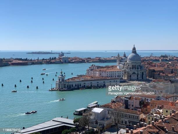 high angle view of city by grand canal against clear blue sky - vgenopoulos stock pictures, royalty-free photos & images