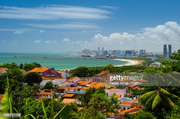 high angle view of city by sea against cloudy sky - recife stock pictures, royalty-free photos & images