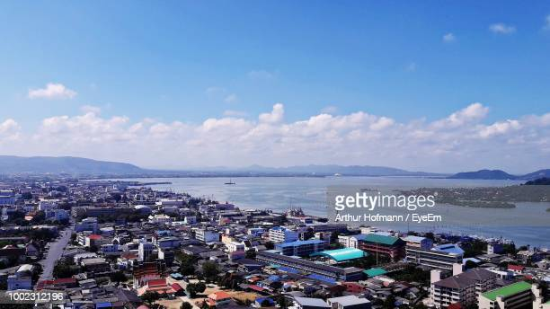high angle view of city by sea against sky - arthur foto e immagini stock