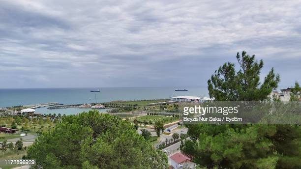 high angle view of city by sea against sky - saka stock pictures, royalty-free photos & images