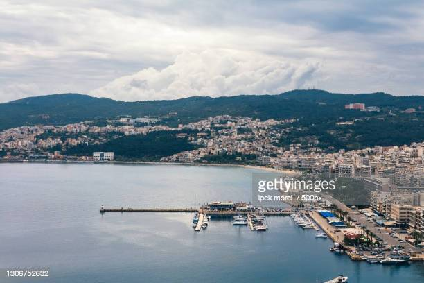 high angle view of city by sea against sky - ipek morel stock pictures, royalty-free photos & images