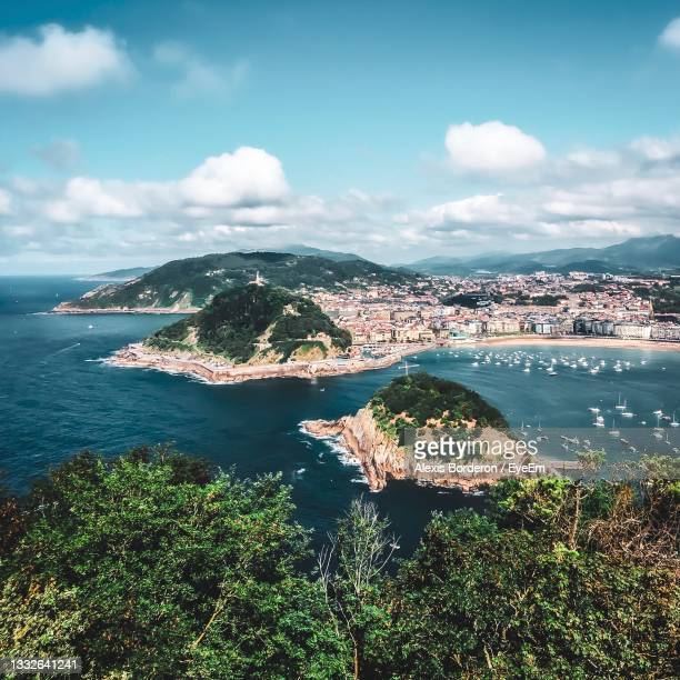 high angle view of city by sea against sky - san sebastian spain stock pictures, royalty-free photos & images