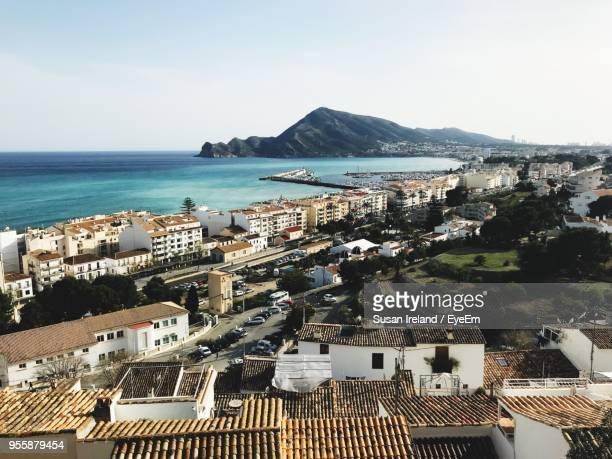 high angle view of city by sea against sky - altea photos et images de collection