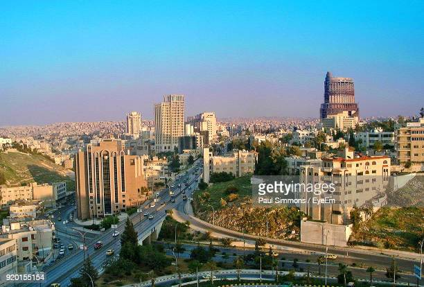 high angle view of city lit up against blue sky - jordanian stock pictures, royalty-free photos & images