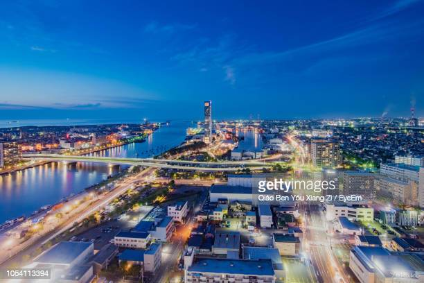 high angle view of city lit up at night - 新潟県 ストックフォトと画像