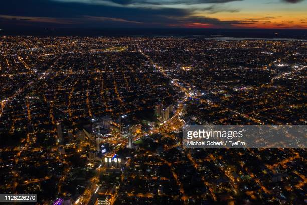 high angle view of city lit up at night - paraguay stock pictures, royalty-free photos & images