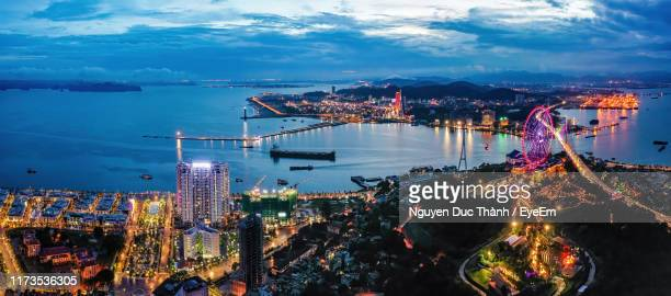 high angle view of city lit up at night - halong bay stock pictures, royalty-free photos & images