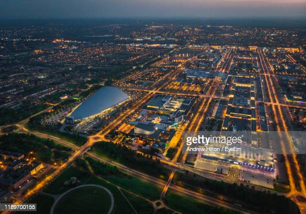 high angle view of city lit up at night - northamptonshire stock pictures, royalty-free photos & images