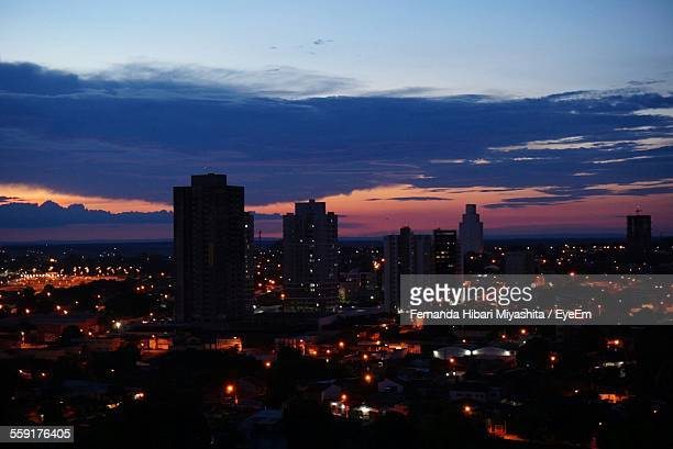 high angle view of city lit up at night - cuiabá stock photos and pictures
