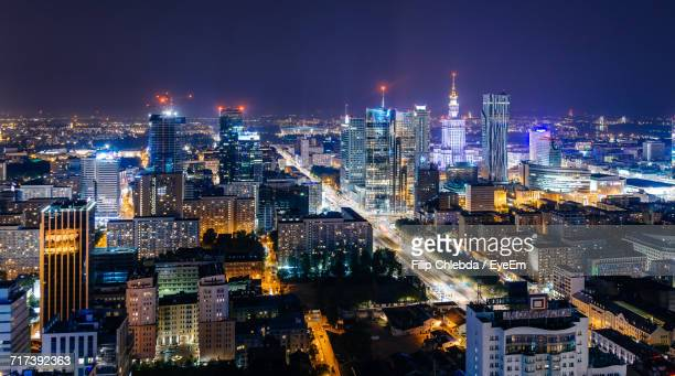high angle view of city lit up at night - warsaw stock pictures, royalty-free photos & images