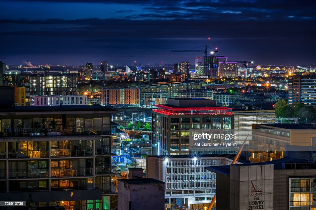 High Angle View Of City Lit Up At Night : Stock Photo