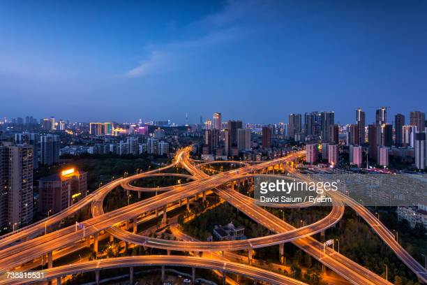 high angle view of city lit up at night - wuhan stock photos and pictures