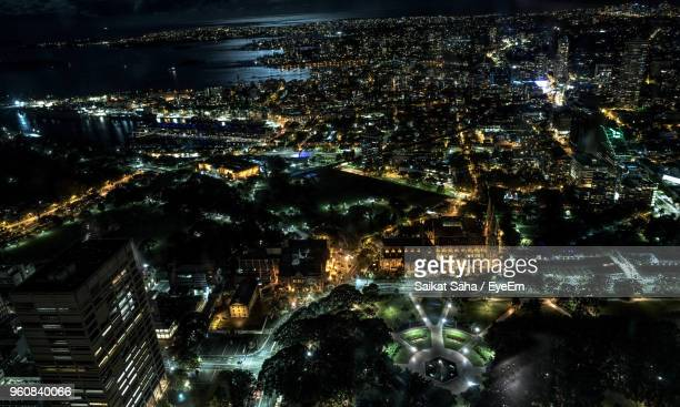high angle view of city lit up at night - saha entertainment stock pictures, royalty-free photos & images