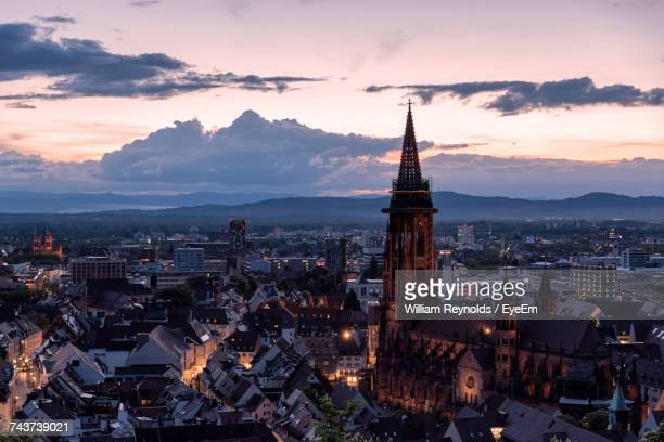 high angle view of city lit up at sunset - freiburg im breisgau stock pictures, royalty-free photos & images