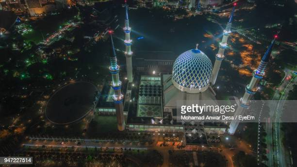 high angle view of city lit up during night - shah alam stock photos and pictures