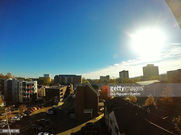 High Angle View Of City On Sunny Day