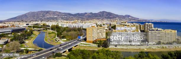 high angle view of city - fuengirola stock photos and pictures