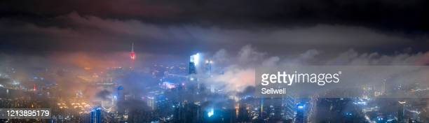 high angle view of city skyline - guangzhou stock-fotos und bilder