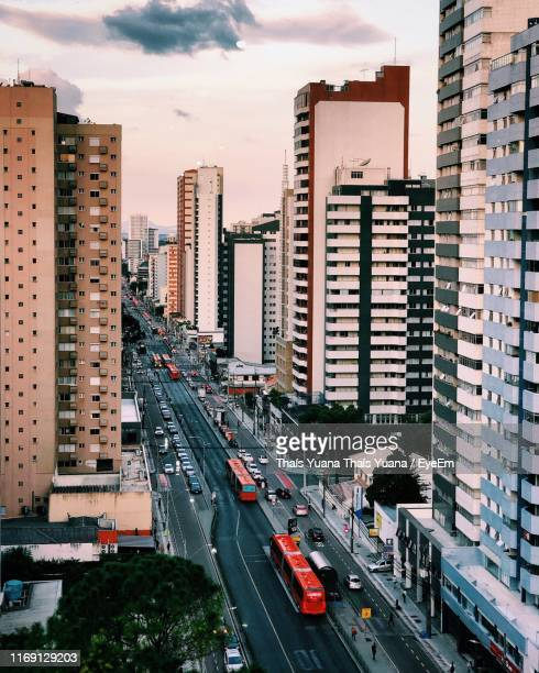 high angle view of city street and buildings against sky - curitiba stock pictures, royalty-free photos & images