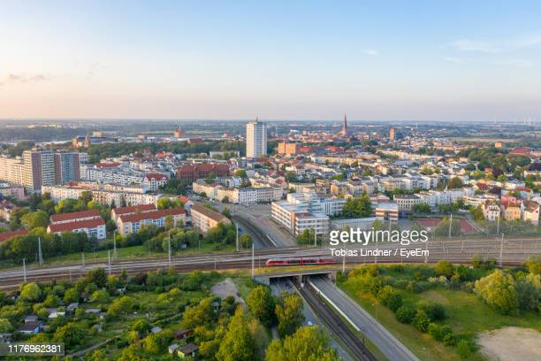 high angle view of city street and buildings against sky - rostock stock pictures, royalty-free photos & images
