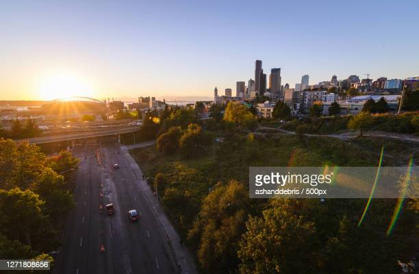 high angle view of city street and buildings against sky, seattle, united states - washington state stock pictures, royalty-free photos & images