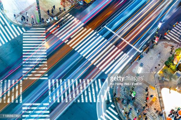 high angle view of city street - tokyo motion ストックフォトと画像