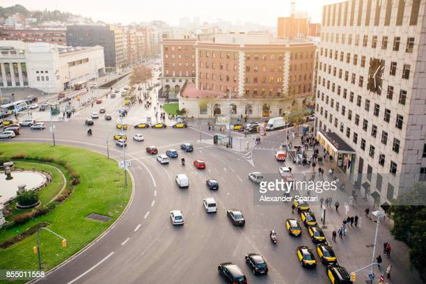 High angle view of city traffic at Plaza Espana, Barcelona, Catalonia, Spain