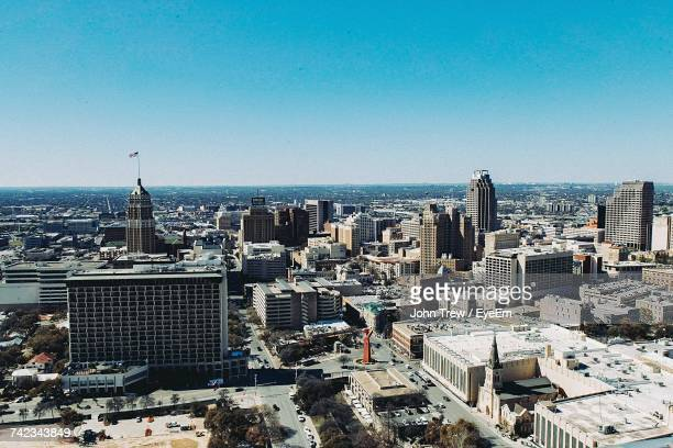 high angle view of cityscape against blue sky - san antonio texas stock photos and pictures