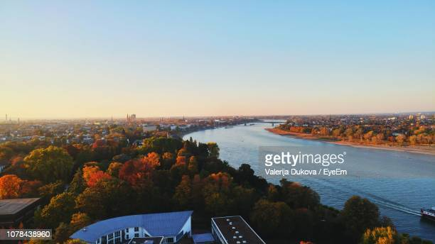 high angle view of cityscape against clear sky - bonn stock-fotos und bilder