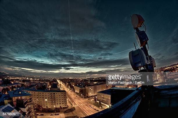 High Angle View Of Cityscape Against Cloudy Sky At Night