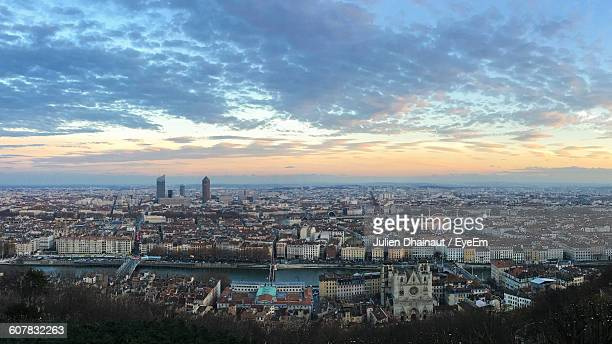 high angle view of cityscape against cloudy sky at sunset - lyon photos et images de collection