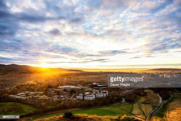 high angle view of cityscape against cloudy sky during sunrise - edinburgh scotland ストックフォトと画像