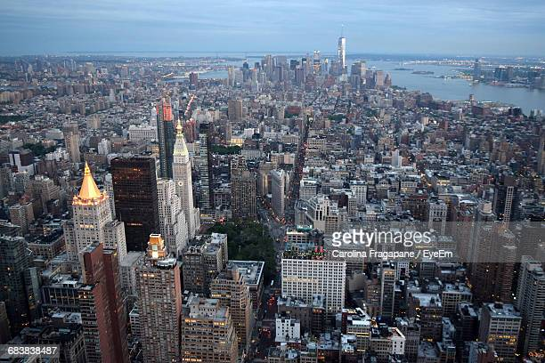high angle view of cityscape against cloudy sky during sunset - carolina fragapane stock pictures, royalty-free photos & images