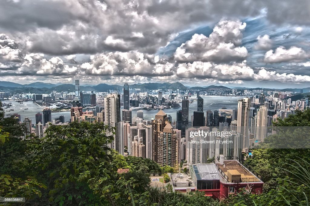 High Angle View Of Cityscape Against Cloudy Sky : Stock-Foto